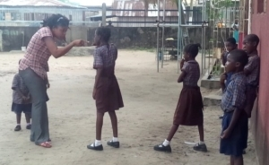 Photos: Teacher In Lagos Forces Her Pupil To Brush Teeth With Sand As Punishment